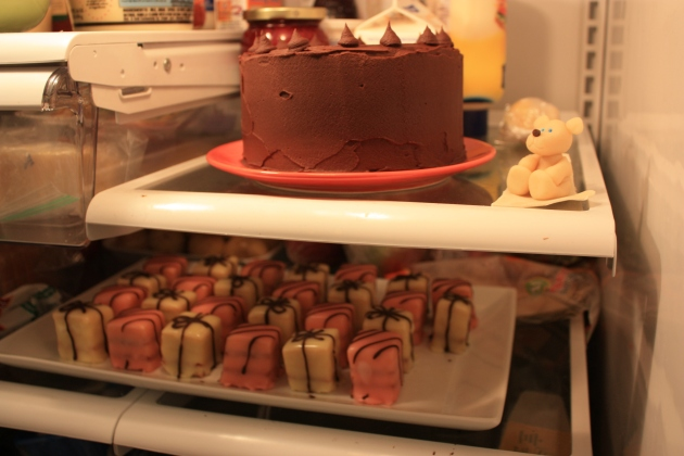 Fridge shelves with cakes on them